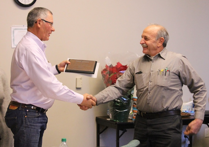 Mayor Joe Piccolo is presented service plaque by Commissioner Bruce Adams