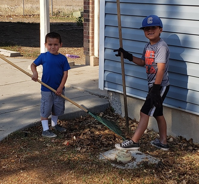 Kids help to clean up around public housing in Carbon County.